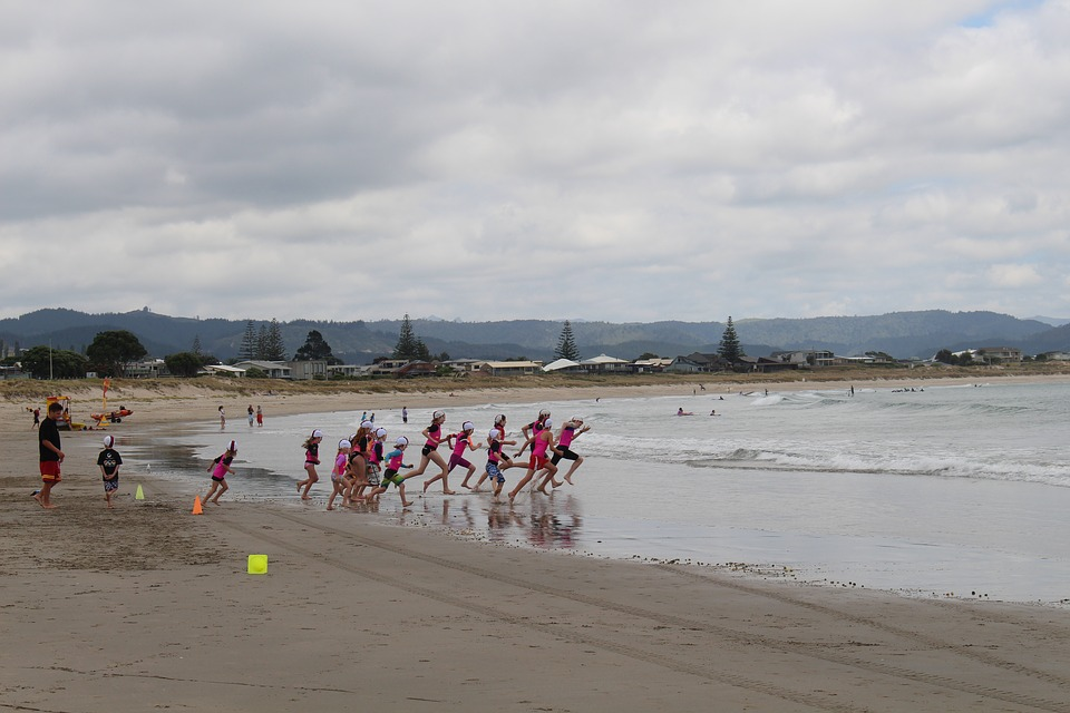 Children learning to swim at the beach