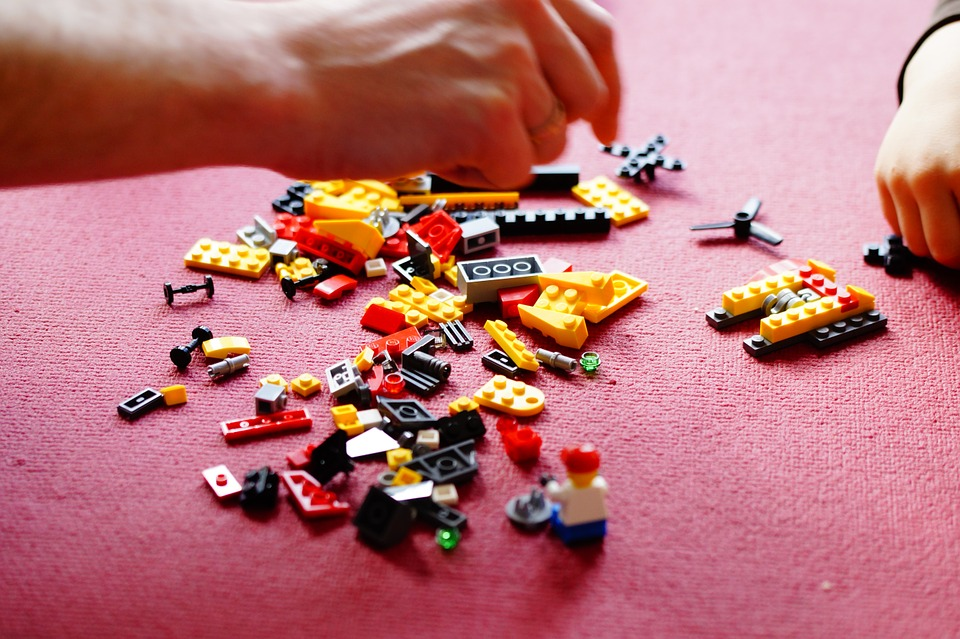People Playing with Lego Blocks